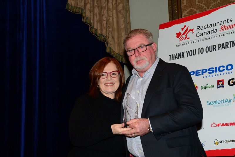 Tim Hortons franchisee Mark Wafer receiving the Restaurants Canada Leadership Award